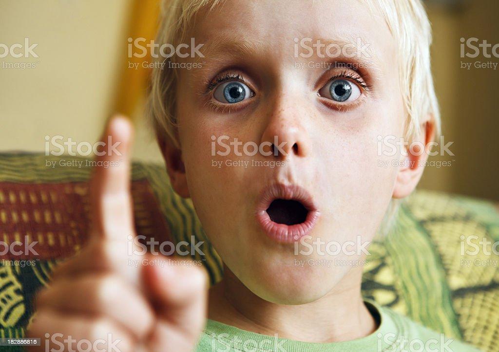 Wide-eyed 7 year old boy is amazed or shocked royalty-free stock photo