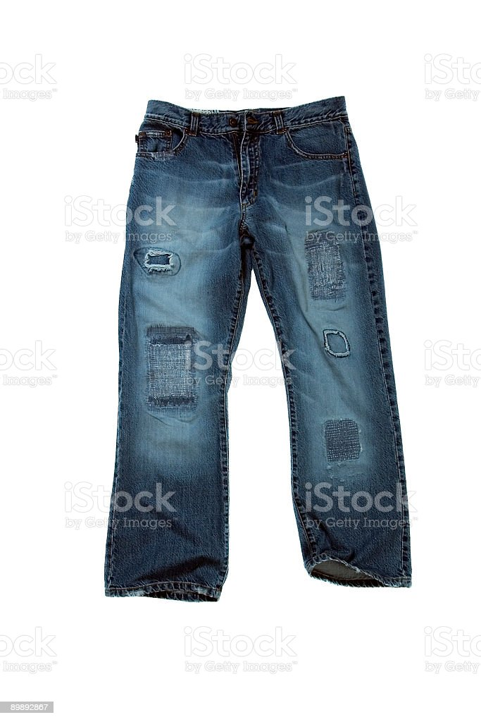 Wide-Leg Blue Jeans With Tears and Patches - White Background royalty-free stock photo