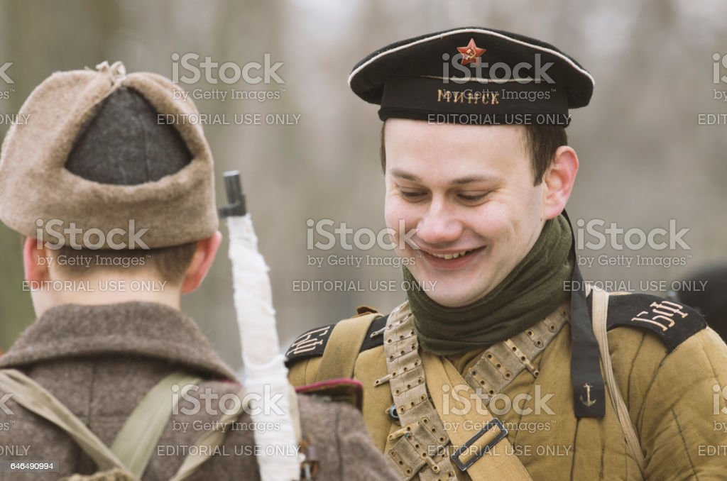 Widely smiling young Soviet sailor of the Baltic Fleet with Flotilla Leader 'Minsk'. stock photo