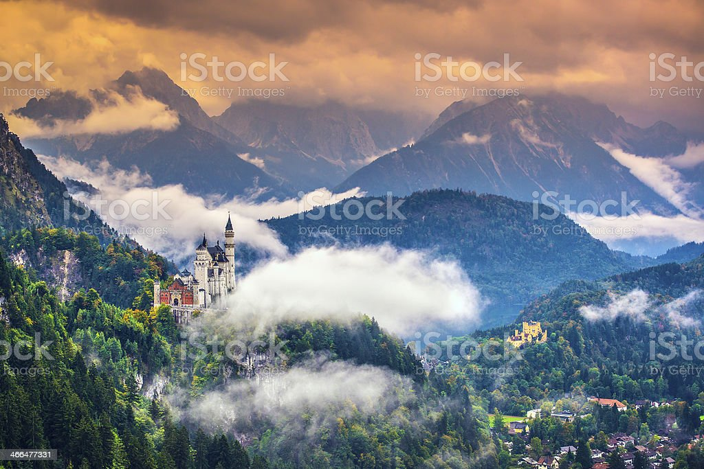 Wide-view of magnificent Neuschwanstein Castle in mountains stock photo