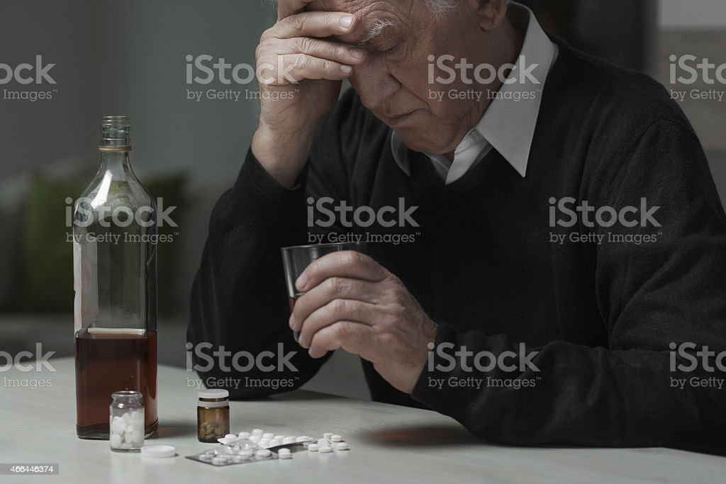 Widower use drugs and alcohol stock photo