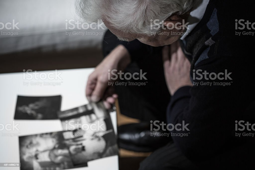 Widower watching pictures stock photo