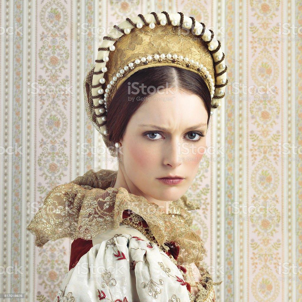 Wielding her royal beauty stock photo
