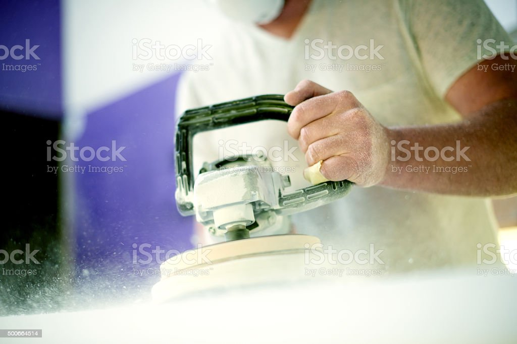 Wielding the sander with great skill stock photo
