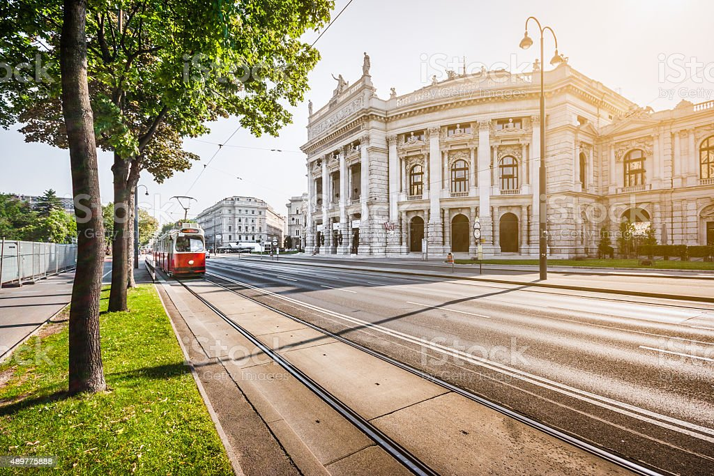 Wiener Ringstrasse with Burgtheater and tram at sunrise, Vienna, Austria stock photo