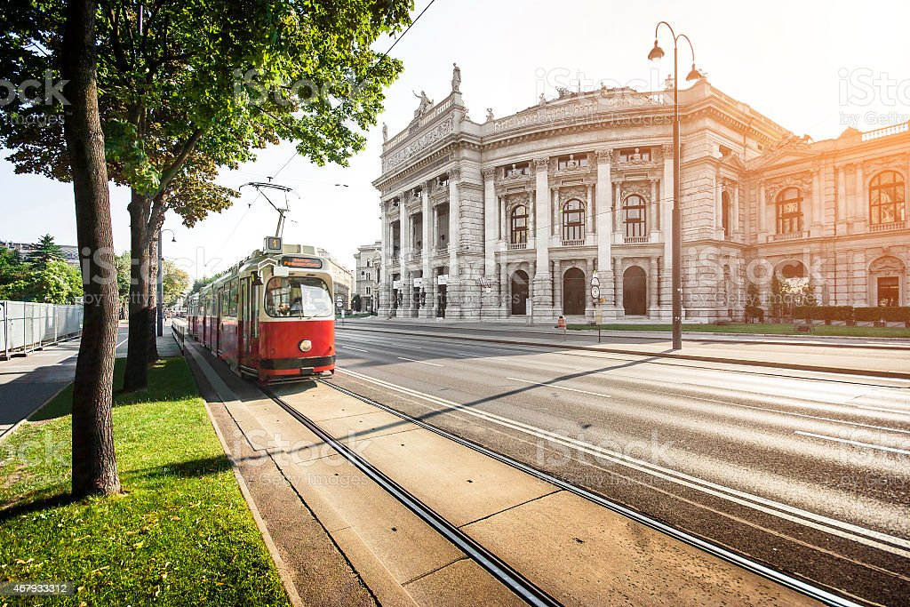 Wiener Ringstrasse with tram and Burgtheater at sunrise, Vienna, Austria stock photo