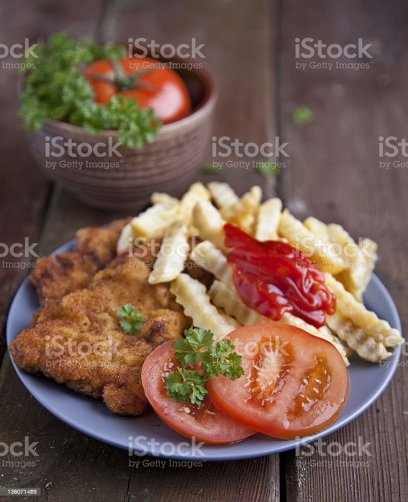 Wiener Schnitzel breaded with French Fries stock photo