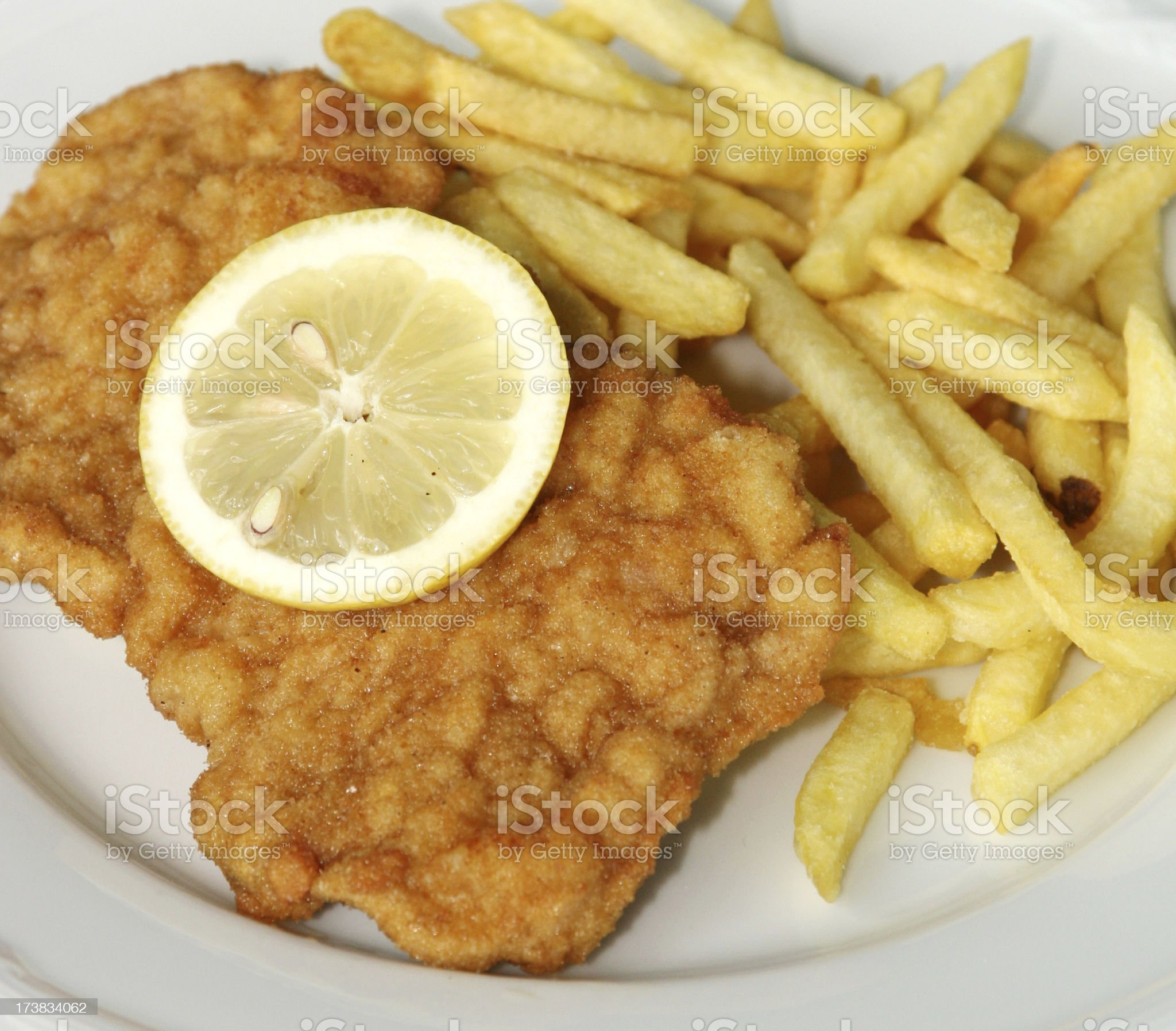 Wiener Schnitzel with French fries royalty-free stock photo