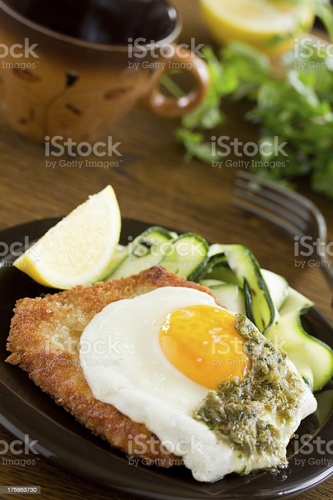 Wiener schnitzel with fried egg and capers. royalty-free stock photo