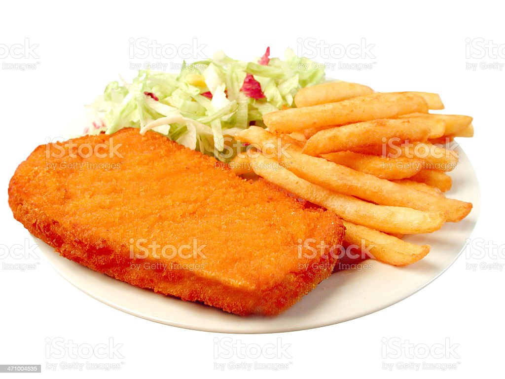 Wiener Schnitzel with fried potatoes and salad stock photo