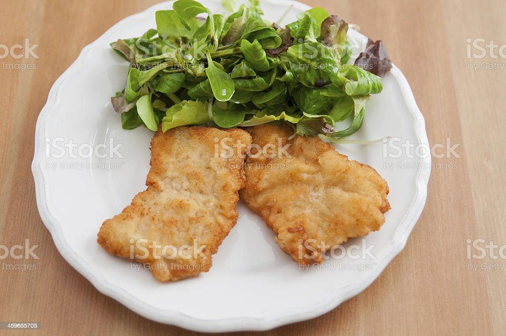 Wiener Schnitzel with green salad stock photo