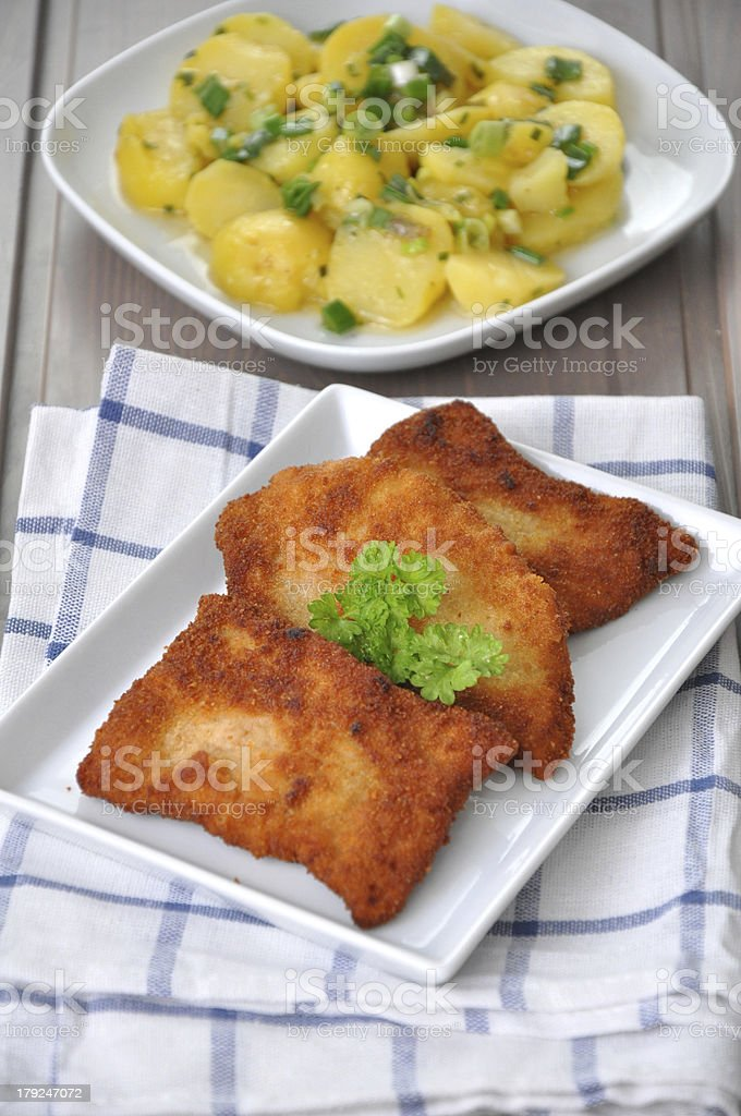 Wiener Schnitzel with potato salad royalty-free stock photo