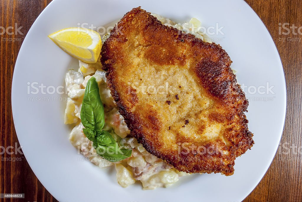 Wiener schnitzel with potato salad stock photo