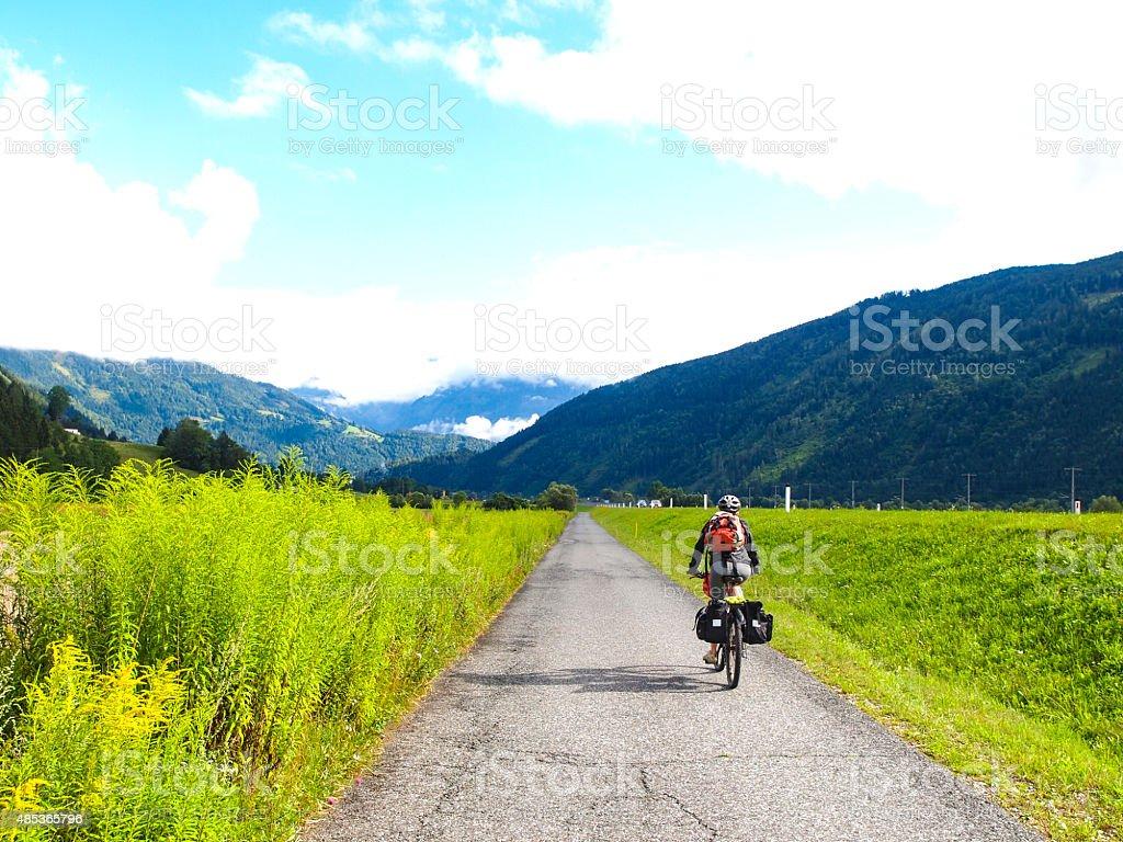 Wiew of drau cycle path with biker near Dellach, Austria stock photo