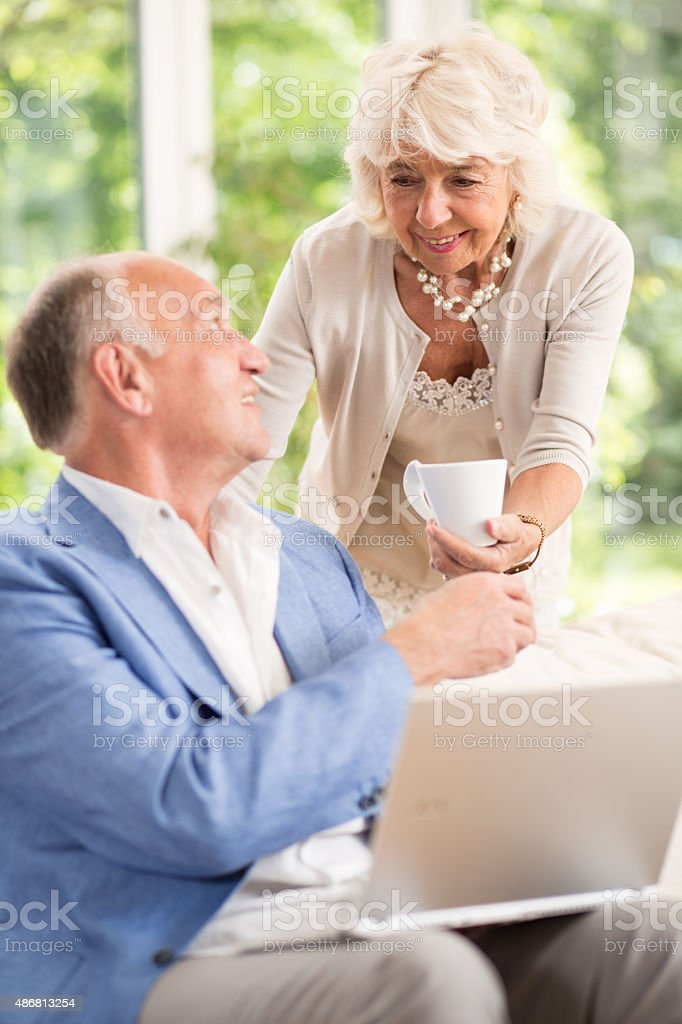 Wife caring about her husband stock photo