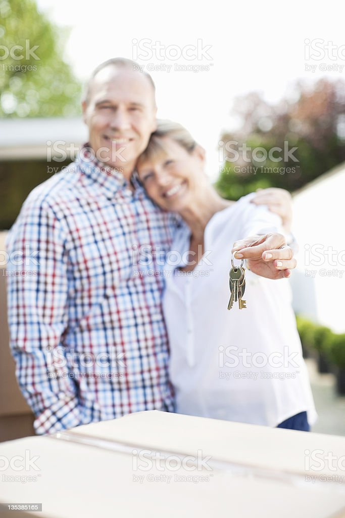 Wife holding keys to new home royalty-free stock photo