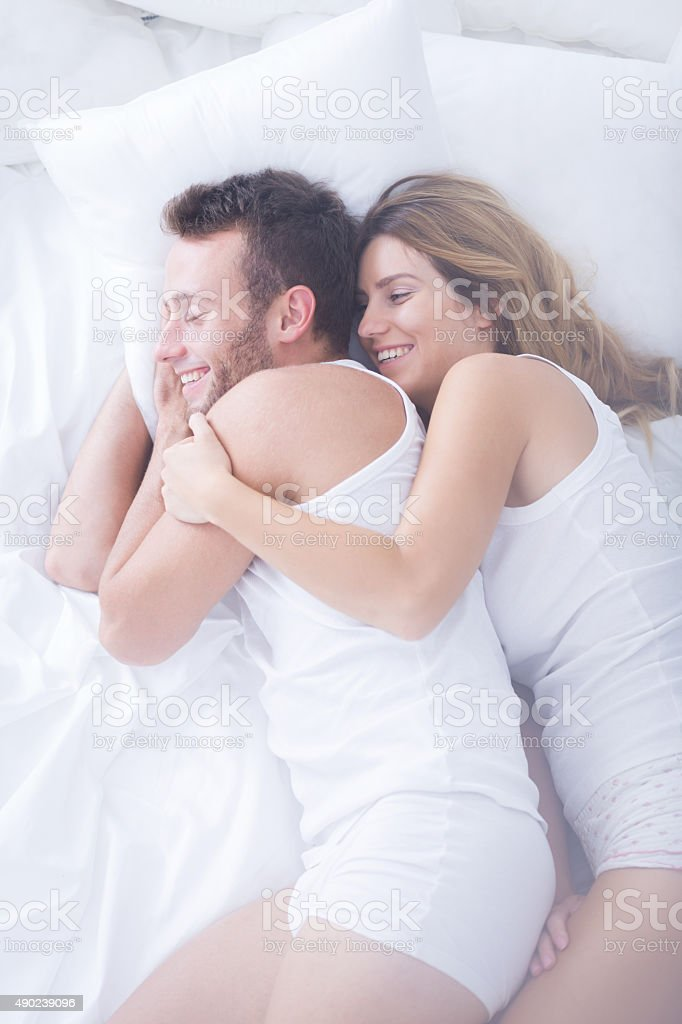 Wife hugging her husband stock photo
