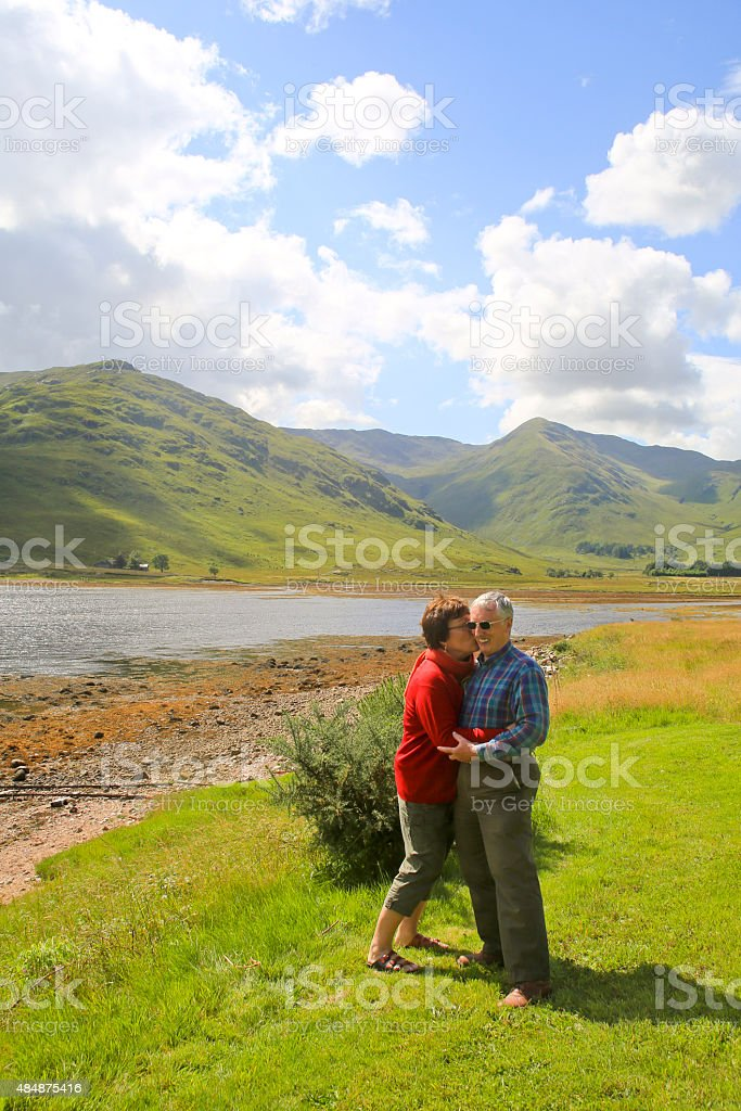 Wife Kissing Husband in Scotish Highlands stock photo