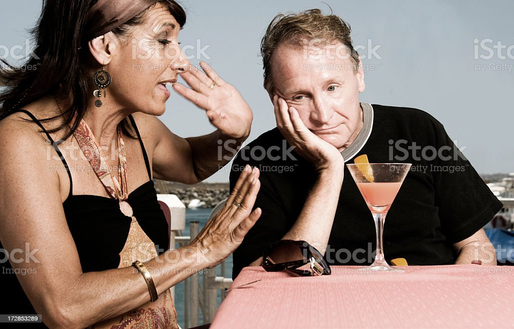 Wife Nagging to Husband on their Vacation royalty-free stock photo