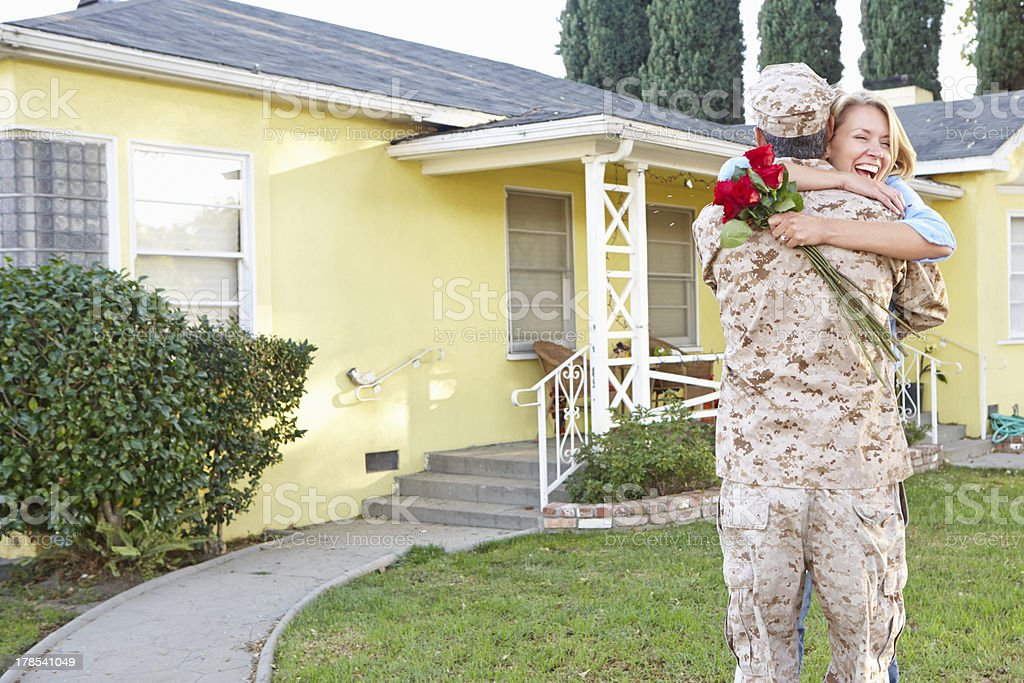 Wife Welcoming Husband Home On Army Leave stock photo