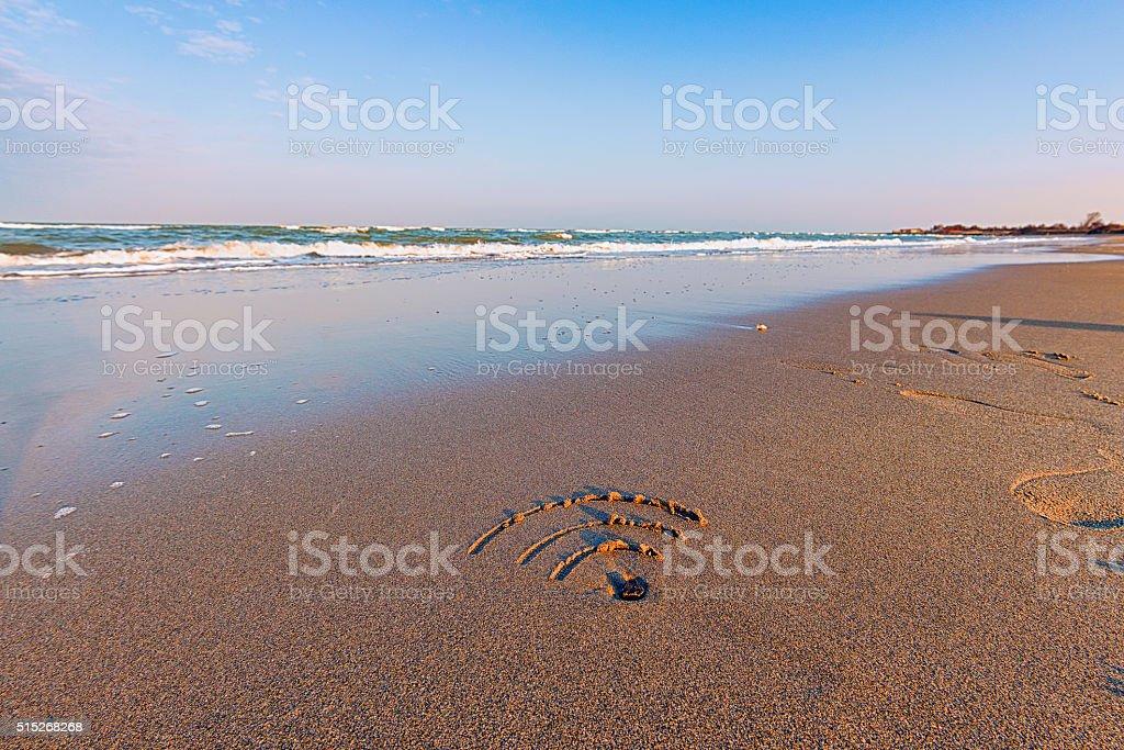 wifi free symbol on the beach stock photo