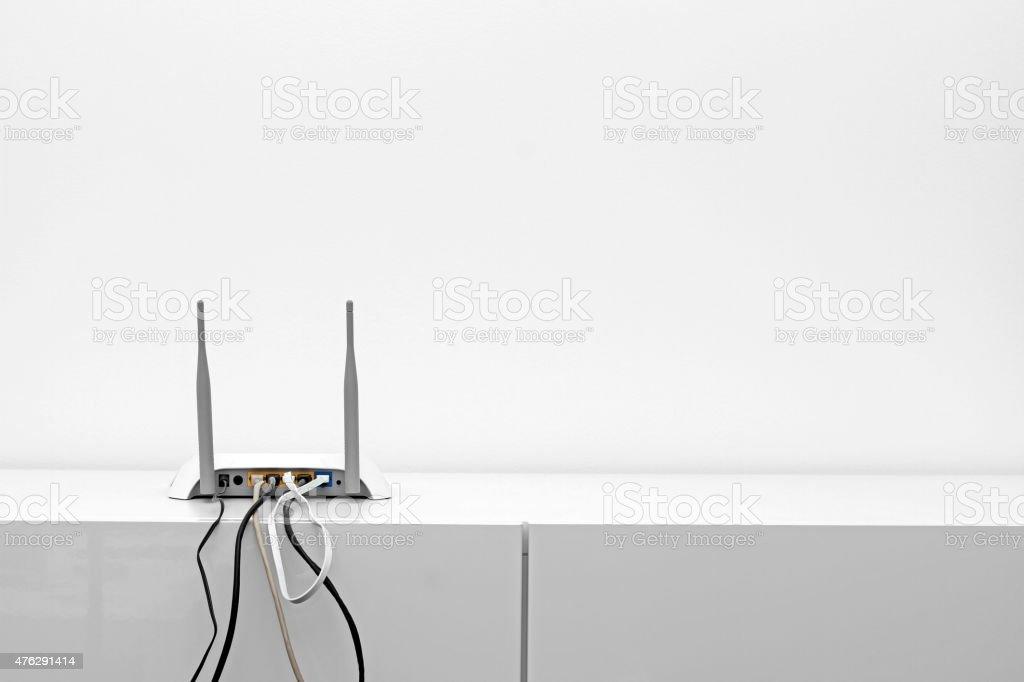 wifi internet router on shelf in white interior stock photo