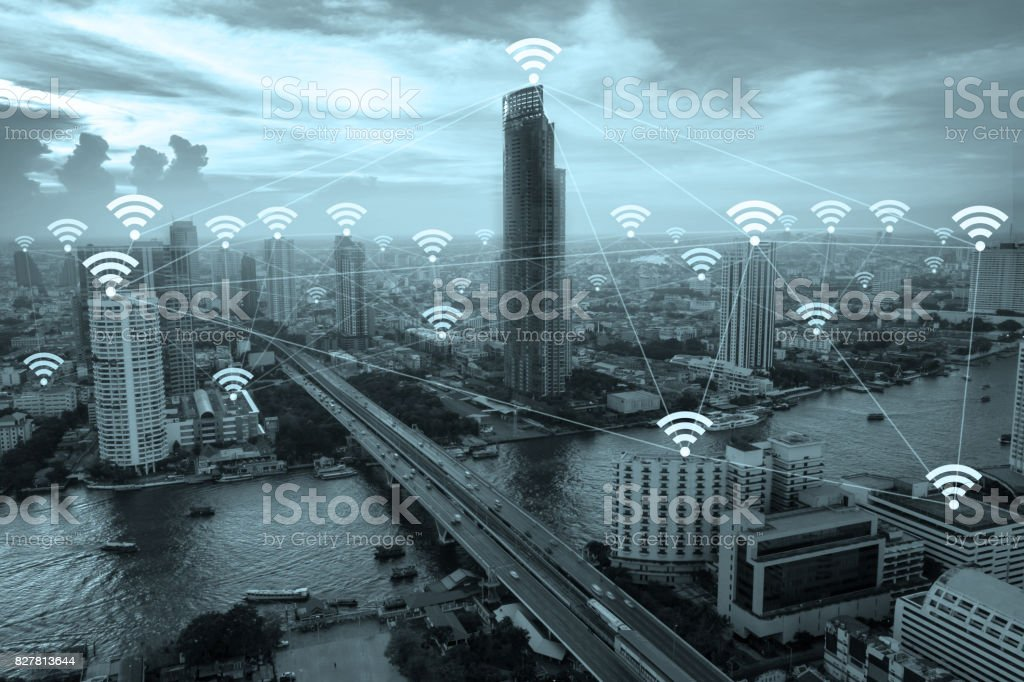 Wifi network connection concept above cityscape background. stock photo