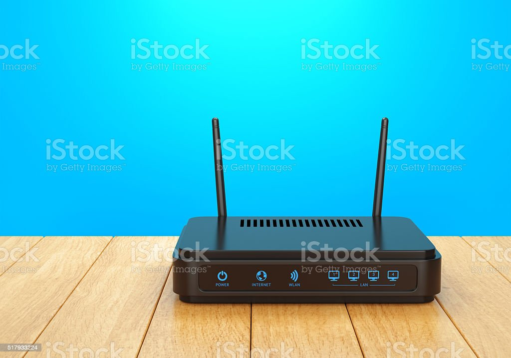 Wi-Fi router on wooden table stock photo
