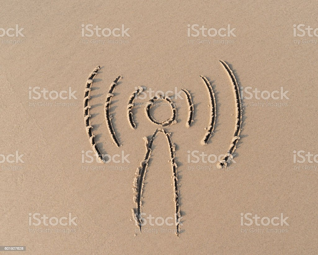 wifi sign on sand beach stock photo
