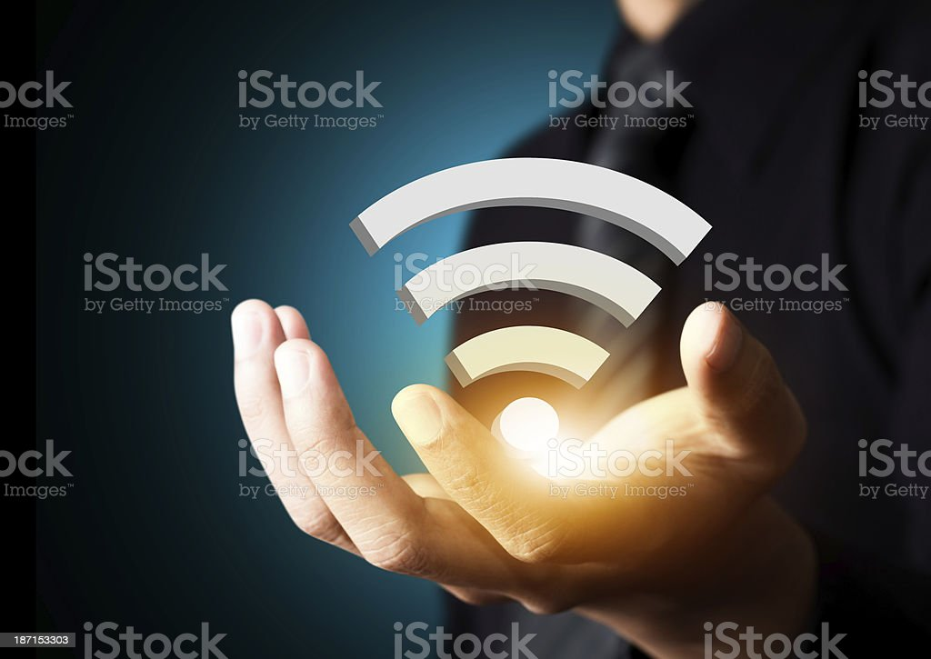 Wifi technology symbol in businessman hand royalty-free stock photo