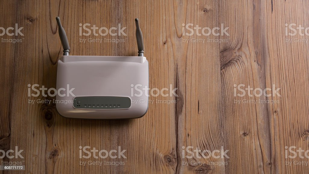 Wi-Fi wireless router on the floor stock photo