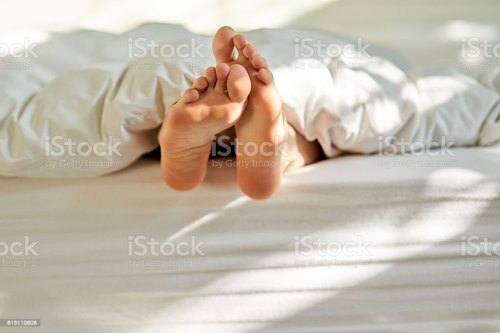 Wiggling toes of wakefulness stock photo