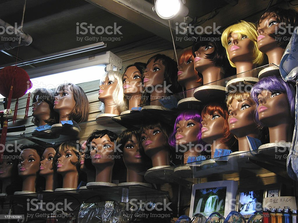 Wigs in a beauty supply store stock photo