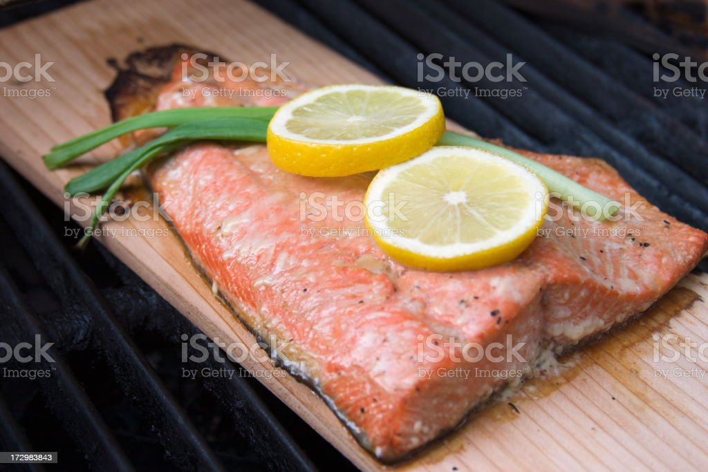Wild Alaskan Salmon On Grill royalty-free stock photo