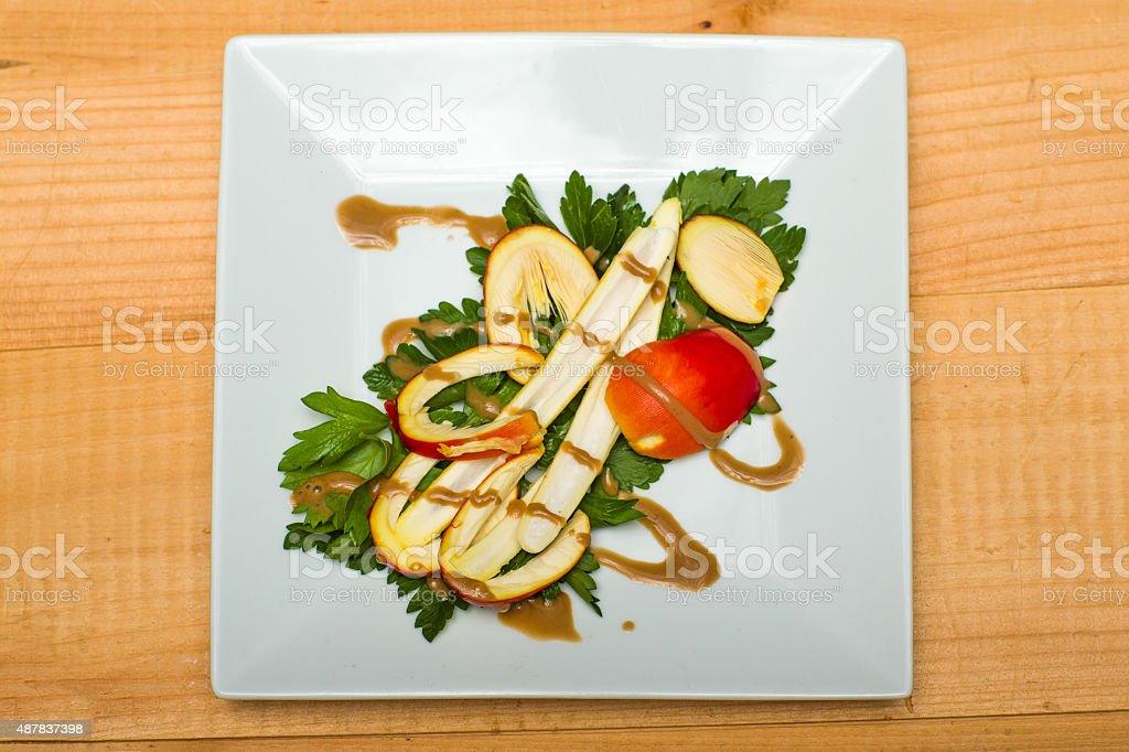 Wild American Caesar's Amanita Salad on a square white plate stock photo