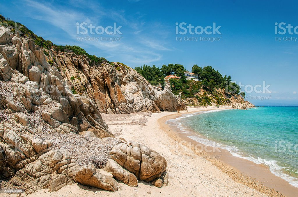 Wild beach in Vourvourou, Sithonia, Greece стоковое фото