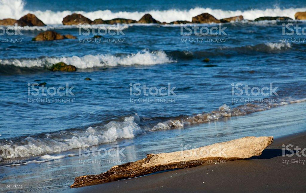 Wild beach, waves and rocks stock photo