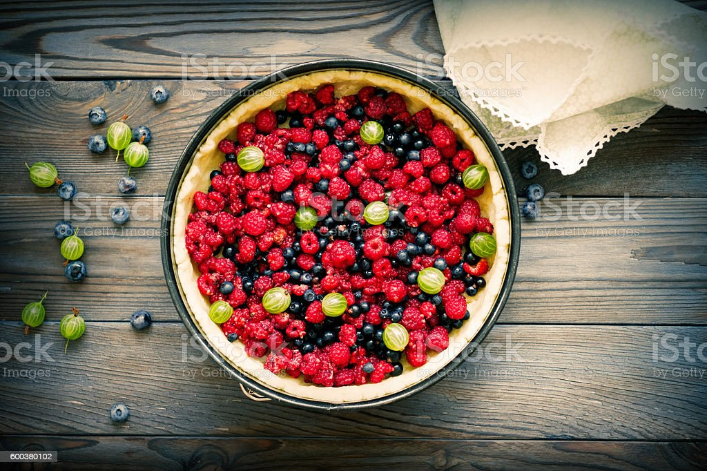 Wild berry pie with raspberries and blueberries stock photo