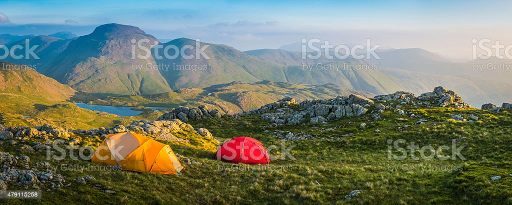 Wild camp tents on mountain top Lake District sunrise panorama stock photo