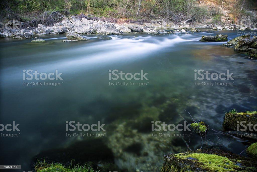 Wild, clear stream. stock photo