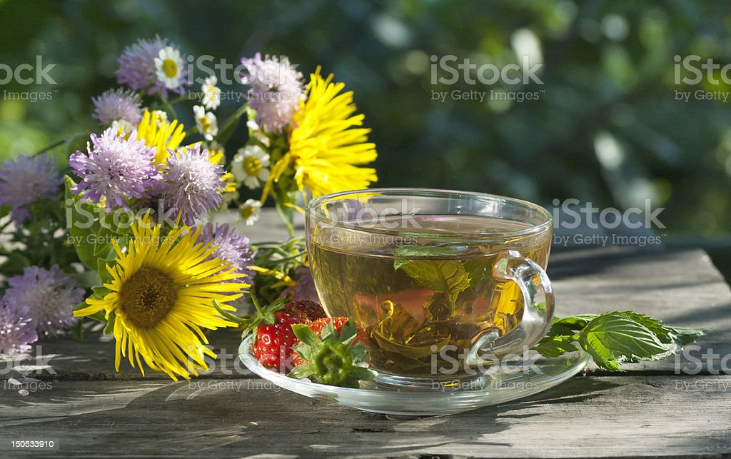 wild flowers, green mint tea and strawberry royalty-free stock photo