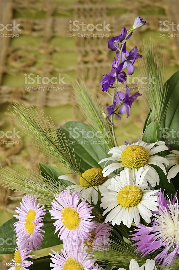 Wild flowers on craft background royalty-free stock photo