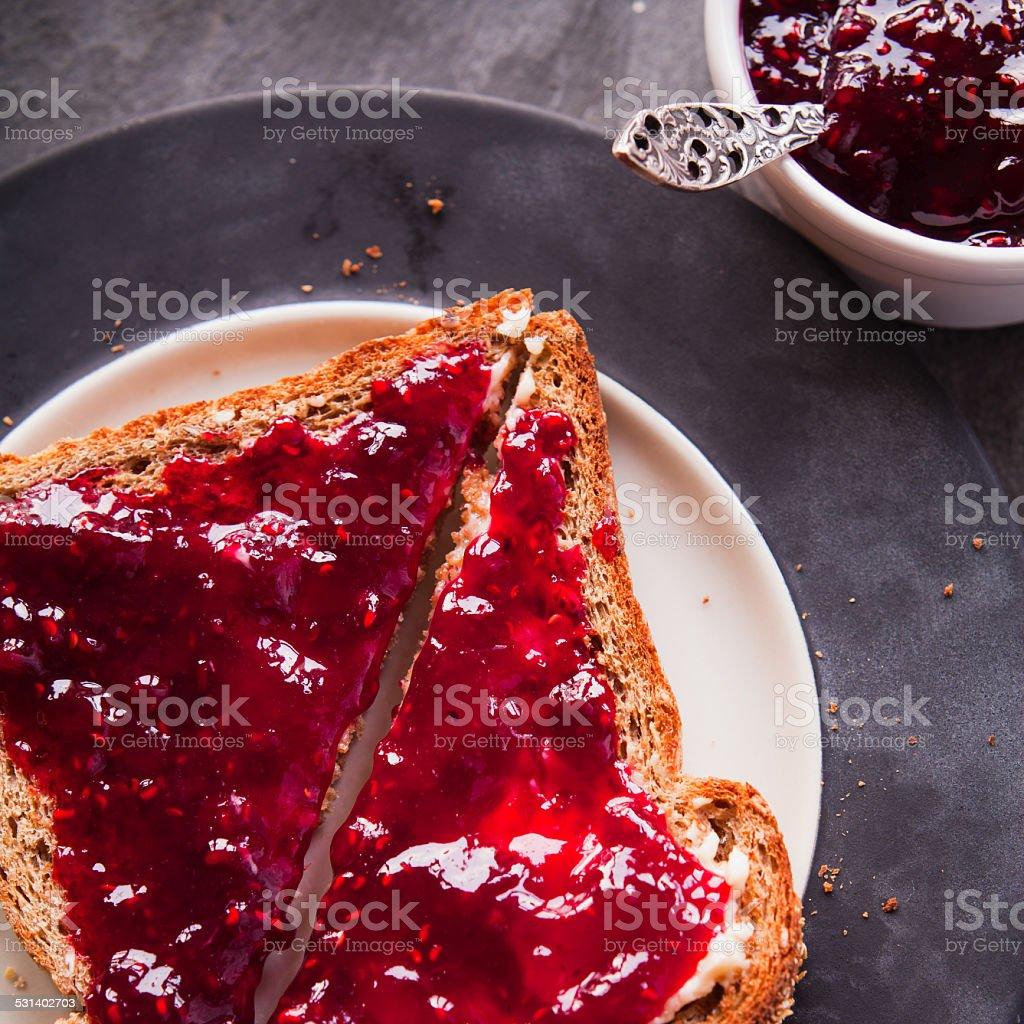 Wild fruit jam on toast bread stock photo