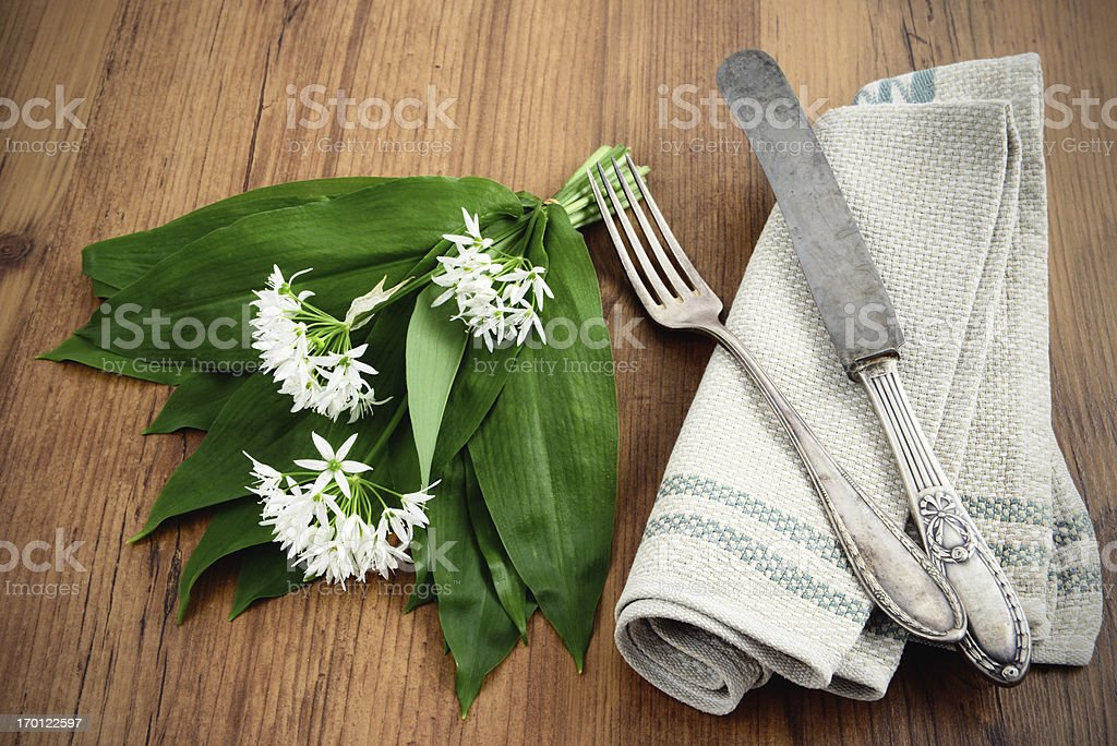 wild garlic (Allium ursinum) and antique silverware stock photo