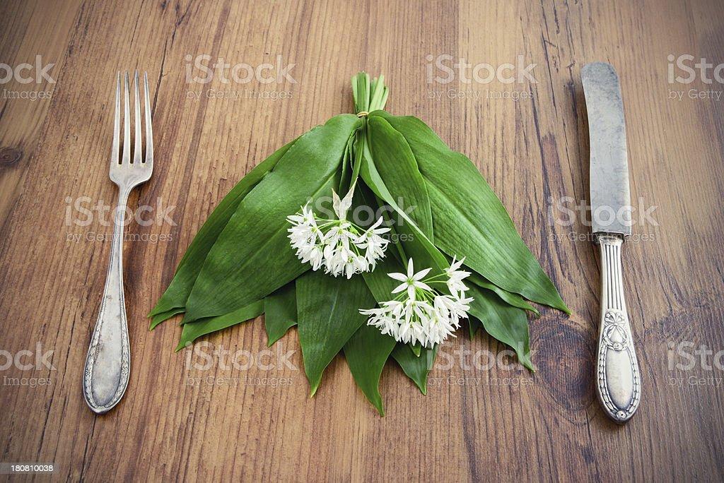 wild garlic (Allium ursinum) and antique silverware royalty-free stock photo