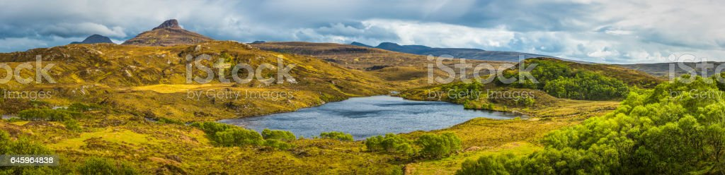Wild Highlands mountain peaks green glens blue lochs Scotland panorama stock photo