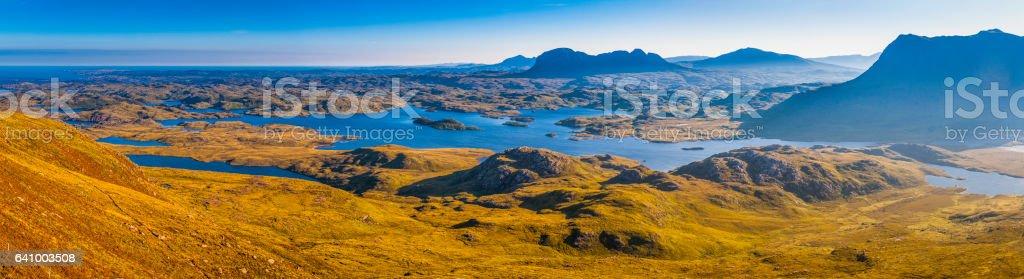 Wild Highlands of Scotland mountain peaks misty glens blue lochs stock photo