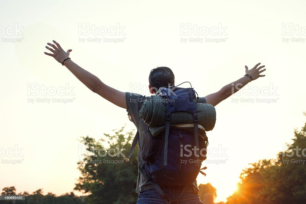 Wild Hiker exulting at sunset stock photo