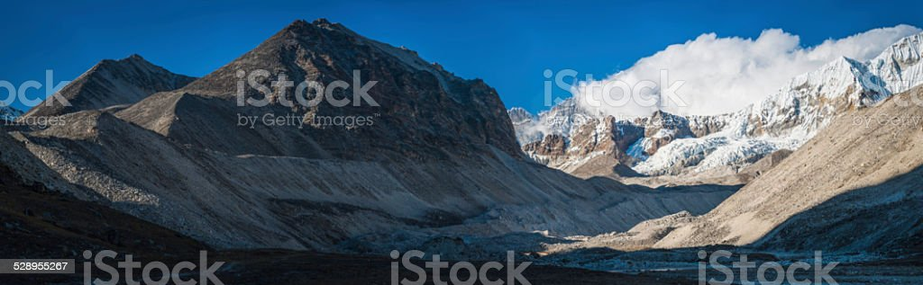 Wild mountain valley glaciers and snow capped peaks Himalayas Nepal stock photo