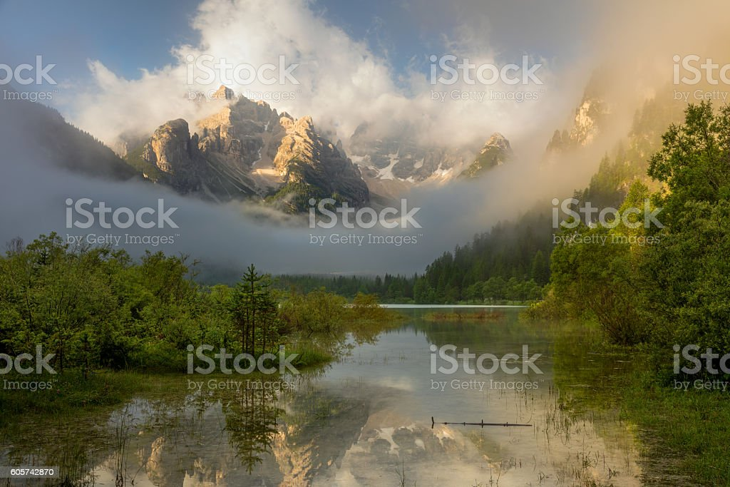 Wild Mountains Lake at foggy sunrise.  Landscape, Alps, Italy, E stock photo